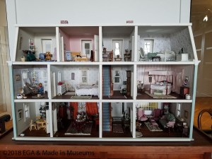 3 story doll house with hand embroidered furnishings