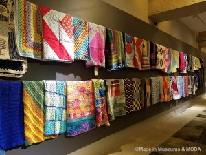 Image of Welcome Blankets hung on the wall welcoming immigrants and letting them know that someone cares