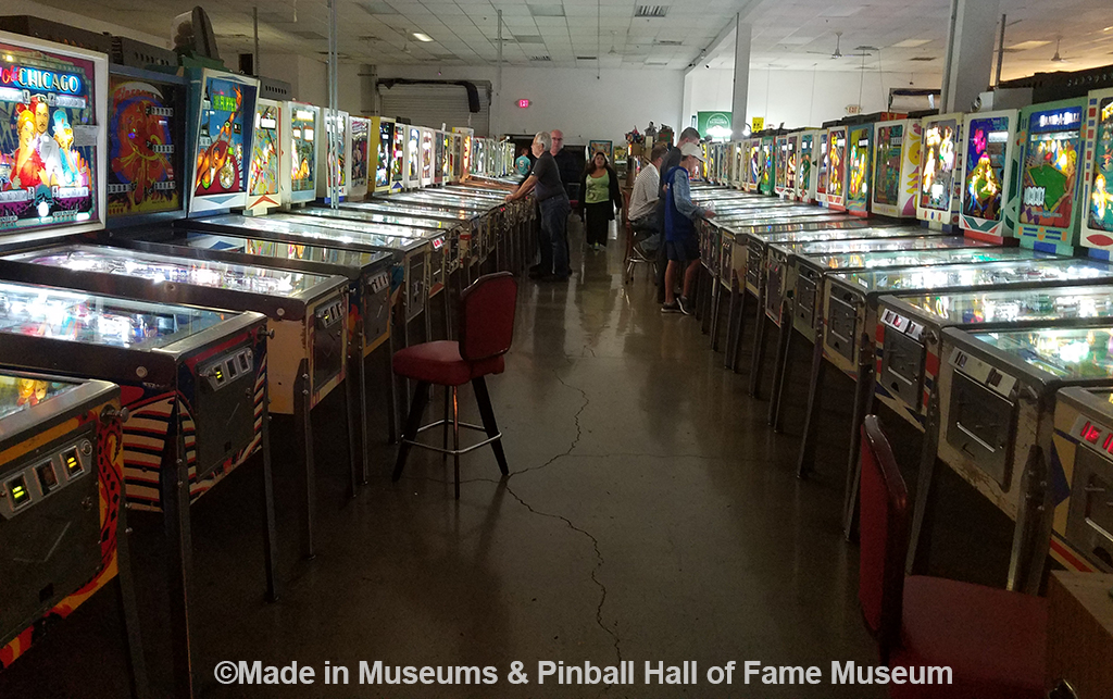 Inside of the museum with the classic games lined up down the aisle