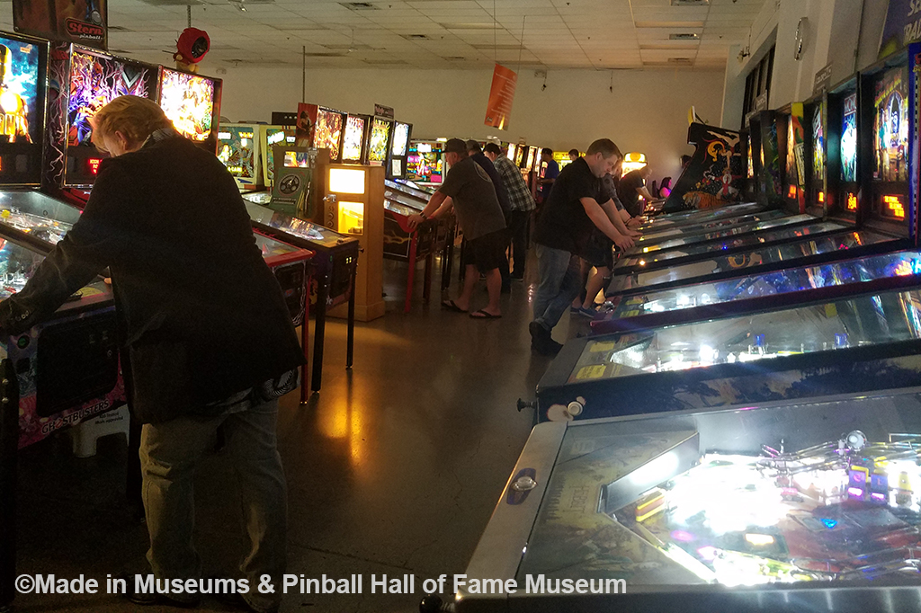 Inside of the museum with pinball machines set up like a traditional arcade