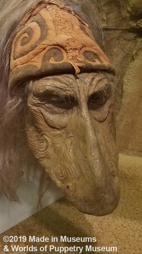 Close-up of the Mystic's face showing the swirls carved into the face.