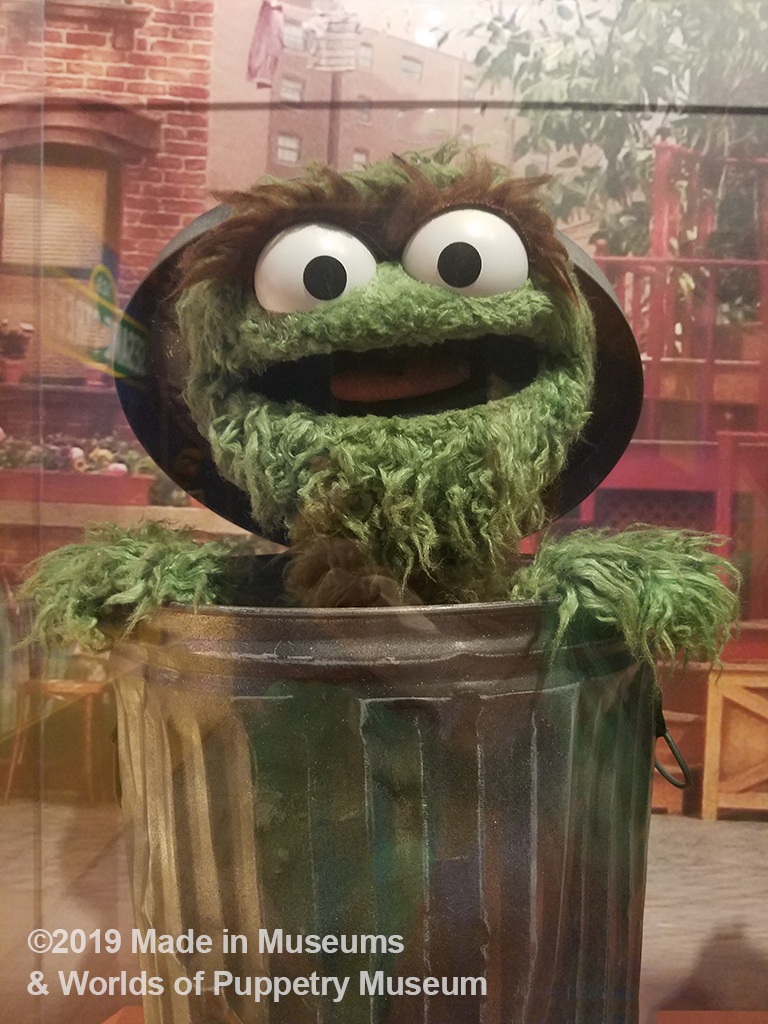 Oscar the Grouch at home in his trash can