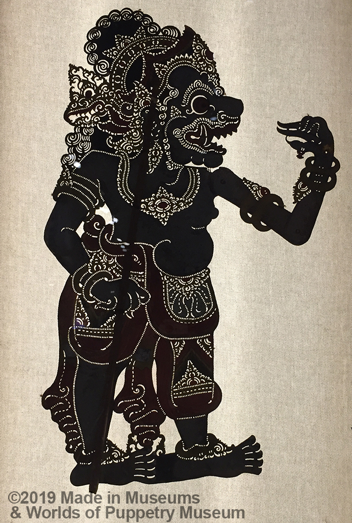 Close-up detail of a shadow puppet from India.