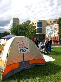 All of the tents on Centennial had sign pushing for Northeastern to reallocate their investment in fossil fuels.