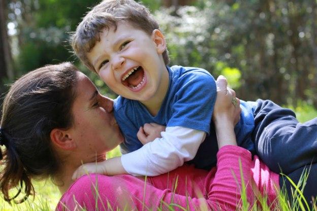 Mum and boy in a vigorous snuggle