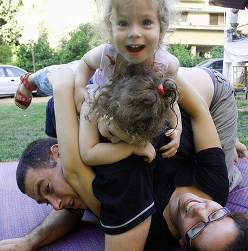 Kids piling on top of parents.