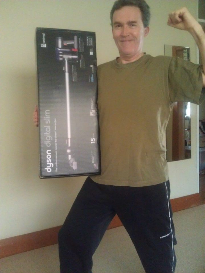 A man shows his housework muscles with a new vacuum cleaner