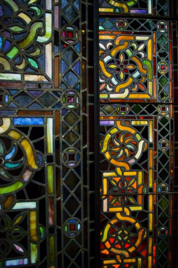 These stained glass windows are also original fixtures.