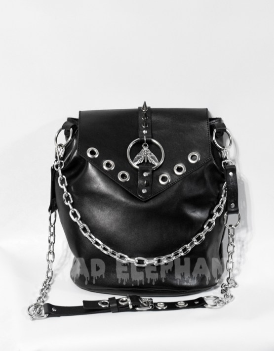 gothic bag with chains, spikes, eyelets and moth pendant
