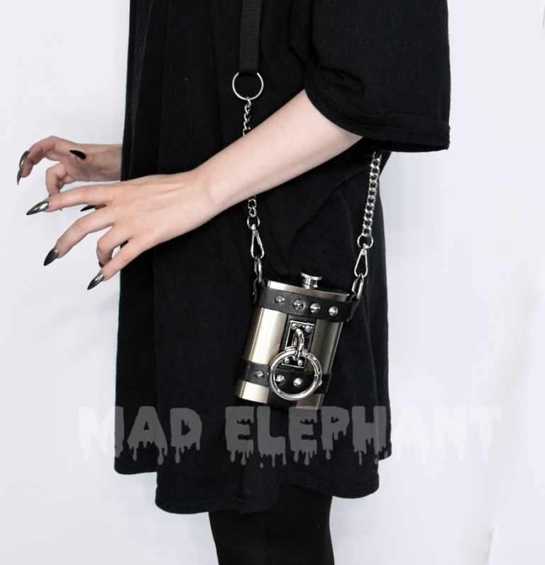 women wears a leather purse with the flask