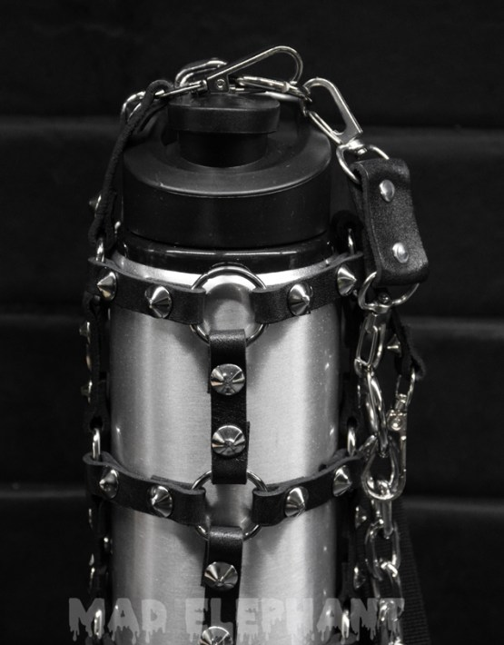 Metal bottle in harness holder with spikes
