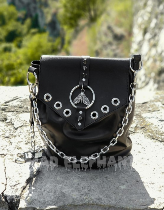 handmade leather bag with moth pendant and eyelets