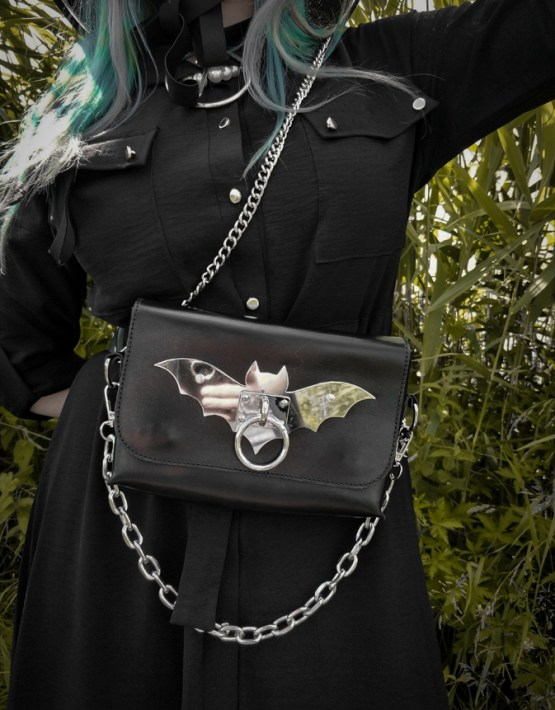 gothic girl with colored hair carries wears kajan bag