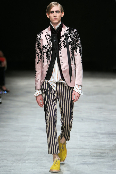 Wearing black and white striped pants and a pink blazer... Image source: Ann Demeulemeester SS 14