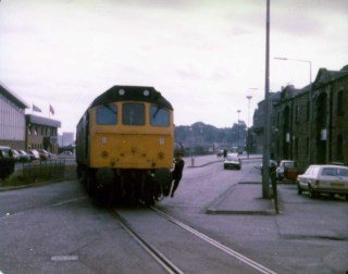 BR train leaving Granton Square heading up to the Texaco Oil Terminal beside Granton Gas Works on the old Caley line