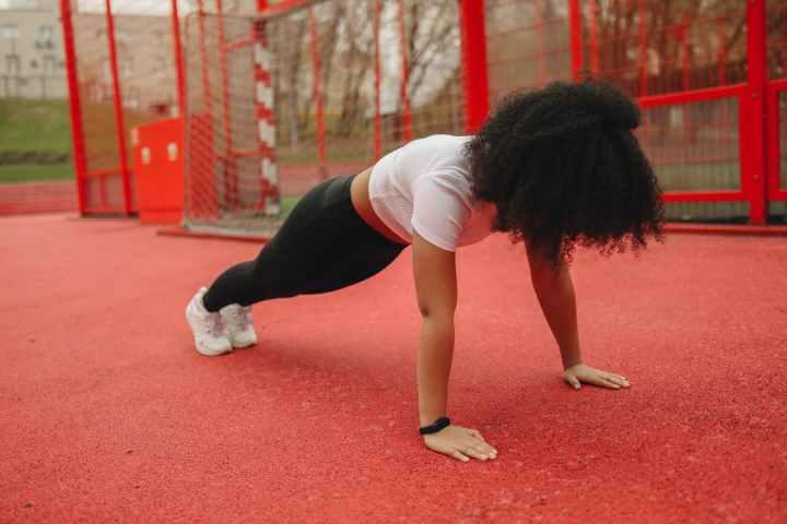 a woman exercising outdoors