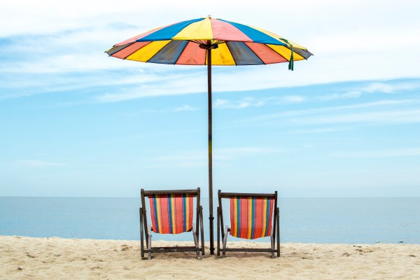 Folding chairs and parasol at the beach | madeofmint.net