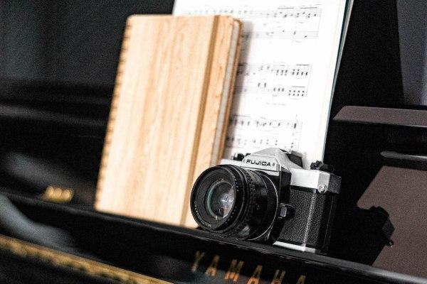Fujica SLR on piano music desk | madofmint.net