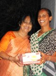 "Dr. Rao's wife, Sabita (on left) is awarding Nagamani, the woman who directs the Mothers' program at Pearly Gates, for winning second place in the ""teachers' division"" of musical chairs. :)"