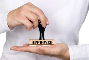 rubber stamp saying approved
