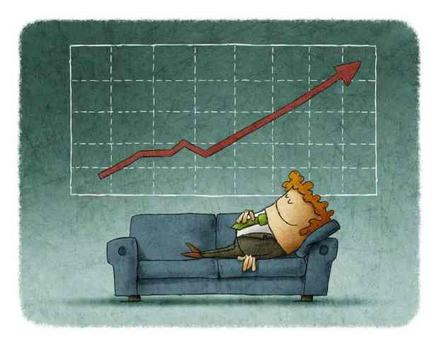 Businessman sleeping on sofa against of successful graph with growing showing