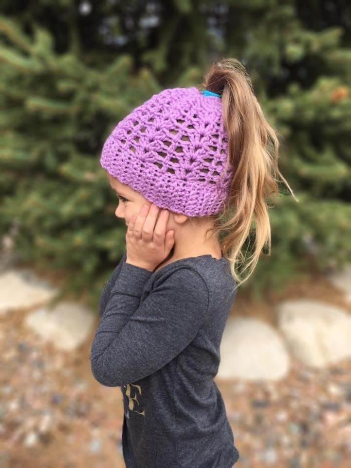 My nieces love their springtime ponytail hats! #freecrochetpattern #crochetponytailhat #crochetbunhat #messybunhat #bunbeanie #springbunhat #springcrochet #crochetforkids #freepattern #freeponytailhatpattern #ponytailhatcrochetpattern #crochetpattern #messybunhatcrochetpattern