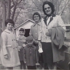 My mom, Myrle, and my sister, Cindy, me, brother Paul, and sister, Patty. I'm wearing gloves, must have been Easter Sunday .