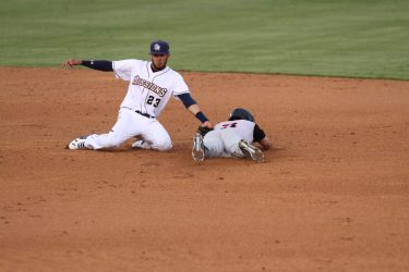 Fernando Tatis, Jr. makes an athletic tag at shortstop.