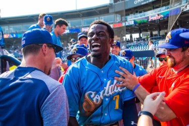 Taylor Trammell celebrates his game-winning grand slam in the Texas League championship series
