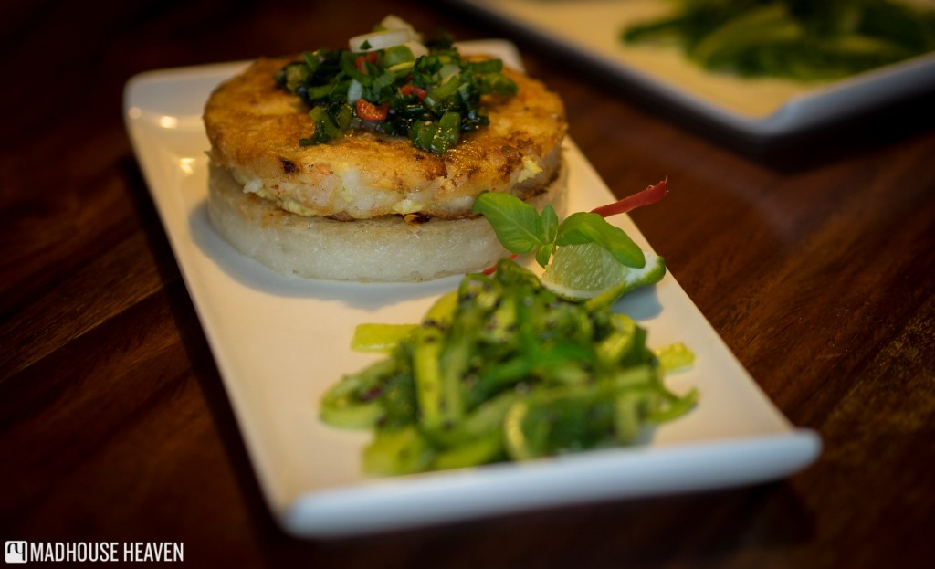 postmodern seafood burger patty on sticky coconut rice bun with wakame salad
