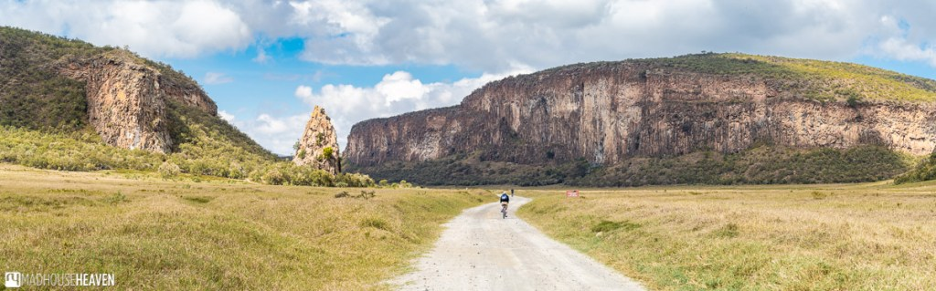 Cyclist riding through the wide expanse of the Hell's Gate National Park