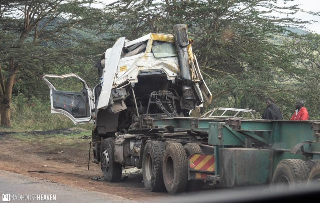 Truck wreck on the side of the road - driving in Kenya is dangerous
