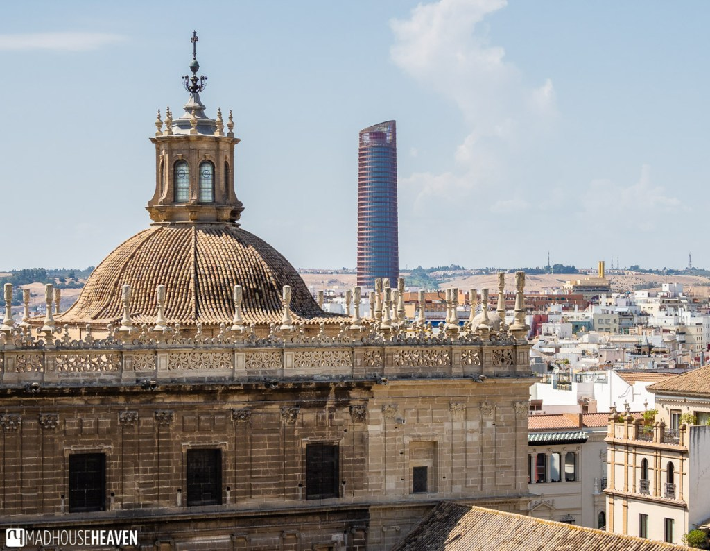 """The Parish Church of the Tabernacle, and the infamous """"lipstick"""" building seen from one of the viewing decks of the Giralda Tower"""