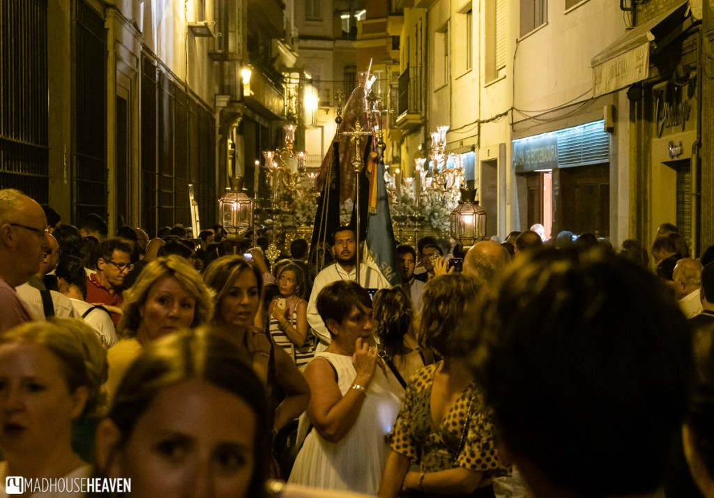 People watching a religious procession in Seville