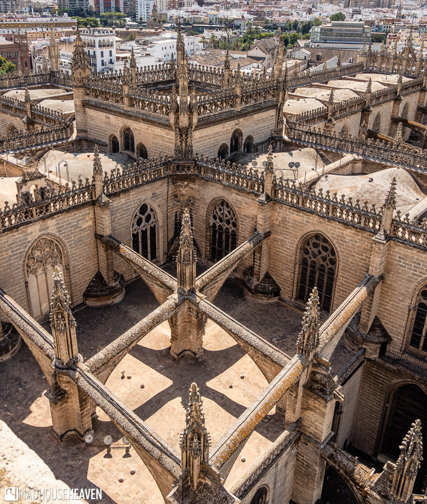 View of the rooftops of Seville Cathedral from Giralda tower, showing the pinnacles and flying buttresses giving support to the walls of the grand church