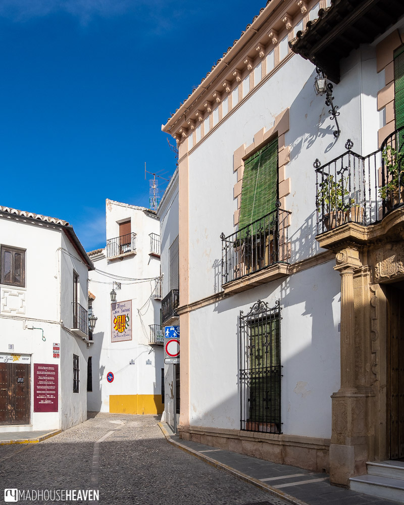 The cobblestoned side street that leads to the Palacio San Gabriel in Ronda