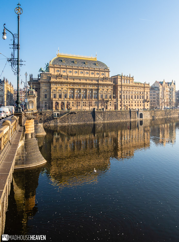 The national theatre of Prague, lit golden by the winter sun