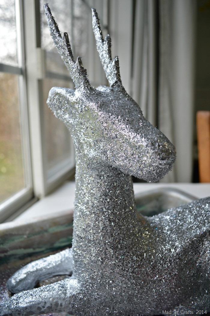 closeup of silver glitter on a paper mache deer