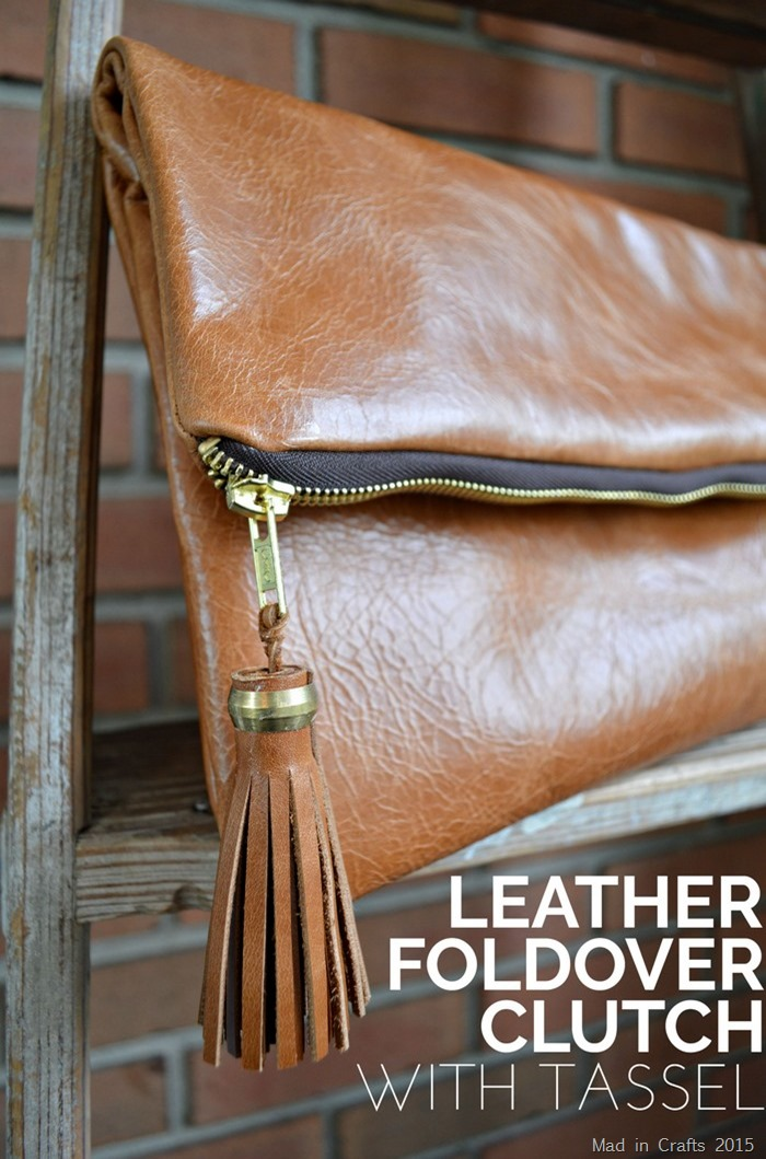 Close up of a leather foldover clutch with a tassell