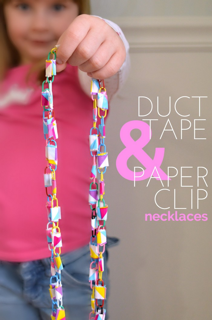 Girl holding a necklace made of duct tape and paperclips