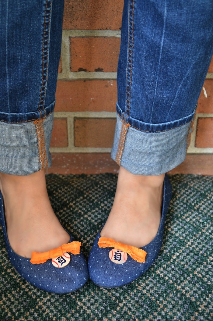 A close up of feet wearing blue shoes