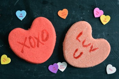 conversation Heart shaped Bath bombs on a black background