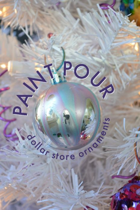 Silver ornament with pink and blue pour paint on a white tree