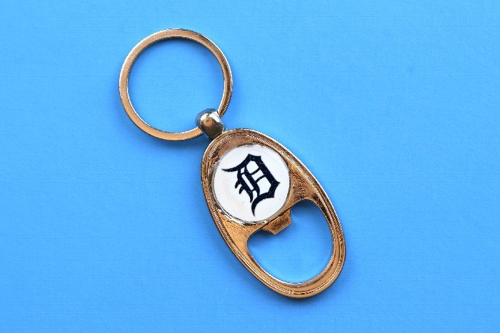 Close up of Detroit Tigers bottle opener key chain