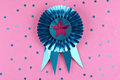 Cricut cut Blue foil ribbon on a pink background with blue foil stars