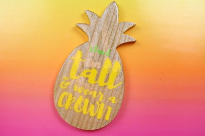 Wood pineapple sign with vinyl that reads Stand Tall & Wear a crown