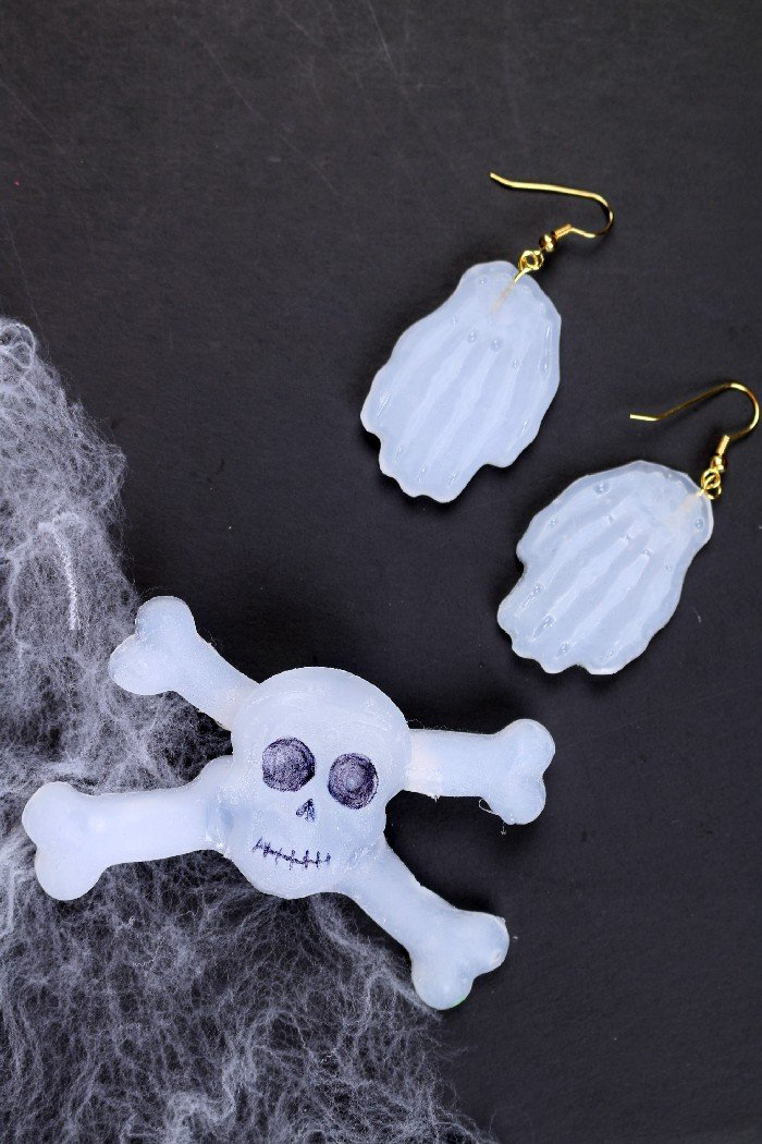 DIY glue gun Halloween jewelry on a black background