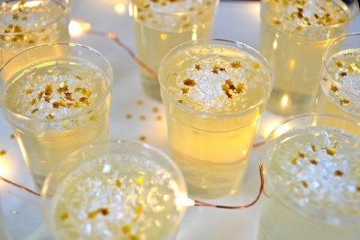 close up of champagne jello shots on a tray
