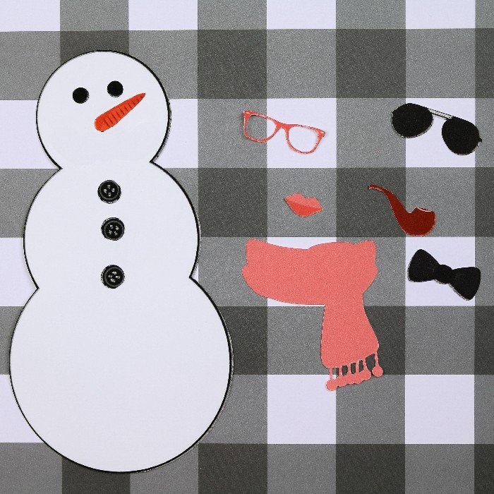 printable snowman paper doll on a plaid background