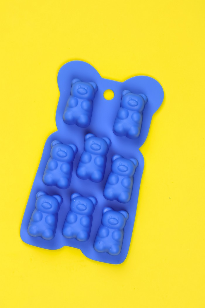 silicone gummy bear mold on a yellow background